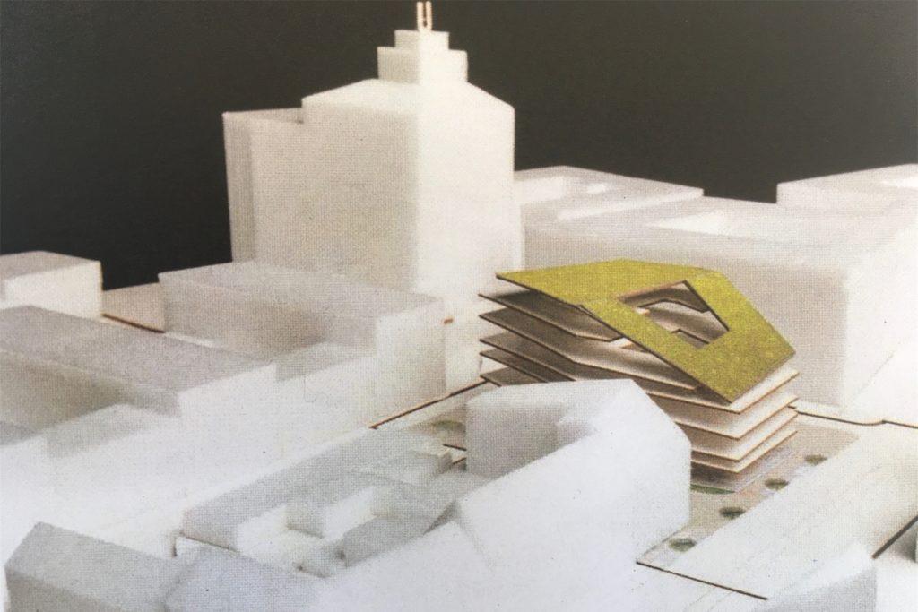 Im Modell fällt der Büroneubau mit seinem begrünten Dach besonders ins Auge.