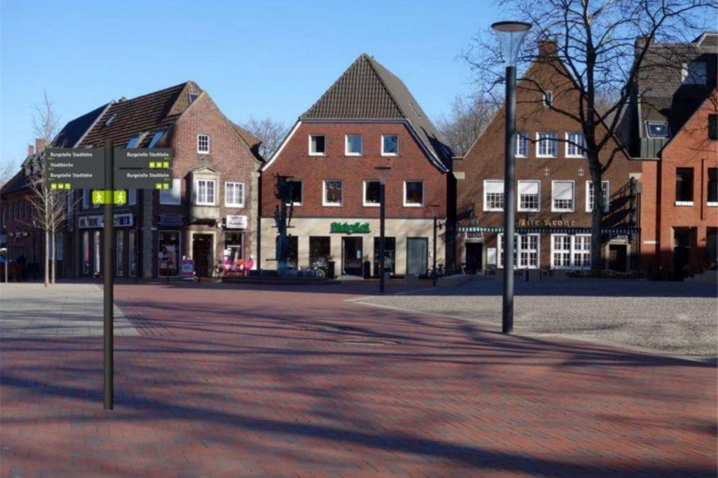 Diese Fotomontage zeigt ein Hinweisschild auf dem Stadtlohner Marktplatz.